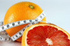 Grapefruit and tape measure. Red grapefruit and tape measure Stock Photos