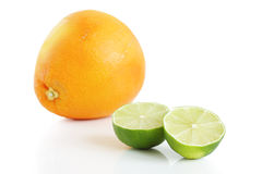 Grapefruit and two lime halves Stock Image
