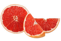 Grapefruit and two slices on a white background Royalty Free Stock Photography