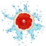 Grapefruit and water. Fresh water splash on red grapefruit stock photos