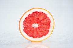 Grapefruit. Wet grapefruit on white background Stock Photography