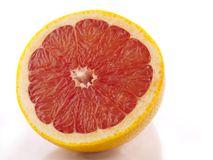 Grapefruit on white. Grapefruit separated on white with water drops Stock Images