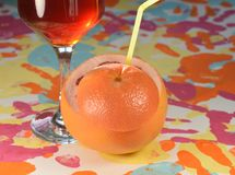 Grapefruit and wine. Glass on a colorful background Stock Images