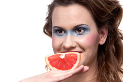 Grapefruit on woman hand Stock Image
