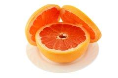 Grapefruitowy na talerzu Zdjęcie Stock
