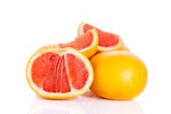 Grapefruitowy odosobniony na białych tło owoc karmowych Zdjęcie Stock