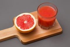 Grapefruitplak en sap Stock Afbeeldingen