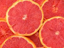 Grapefruits. Slices of grapefruit for background Stock Photos
