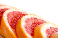 Grapefruits. Citrus Fruits - pink sliced grapefruit also for background Royalty Free Stock Images