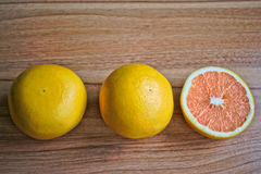 Grapefruits. Closeup of grapefruits on a wooden table Royalty Free Stock Photography