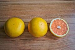 Grapefruits. Closeup of grapefruits on a wooden table Stock Photos