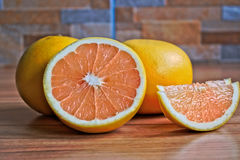 Grapefruits. Closeup of grapefruits on a wooden table Stock Image