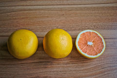 Grapefruits. Closeup of grapefruits on a wooden table Royalty Free Stock Image