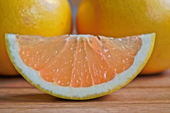 Grapefruits. Closeup of grapefruits on a wooden table Stock Photography