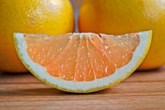 Grapefruits. Closeup of grapefruits on a wooden table Royalty Free Stock Photo