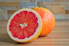 Grapefruits. Closeup of grapefruits on a wooden table Stock Images