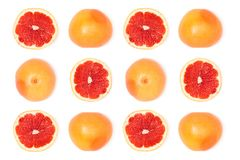 Grapefruits. Composition of fresh ripe grapefruits isolated on white Royalty Free Stock Photos