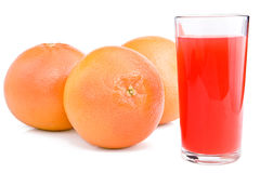 Grapefruits and glass of juice. Grapefruits and glass of juice are isolated on the white Stock Photos