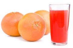 Grapefruits and glass of juice. Stock Photos