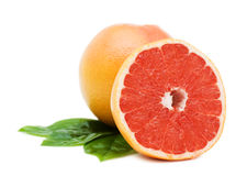 Grapefruits with green leafs Royalty Free Stock Images