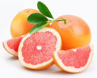 Grapefruits group with leaves Royalty Free Stock Photography
