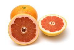 Grapefruits isolated on white. Grapefruit halves isolated on a white background Royalty Free Stock Photography