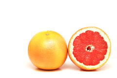 Grapefruits isolated on white. Grapefruits, one cut in half, isolated on white Royalty Free Stock Images