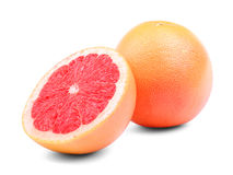 Grapefruits isolated on a white background. A whole and a cut round grapefruit. Organic ingredients for summer cocktails. Stock Image