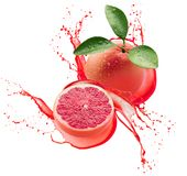 Grapefruits in juice splash isolated on a white background Stock Images