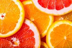 Grapefruits  and oranges background Stock Image