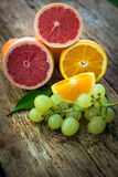 Grapefruits,oranges and grapes. Placed over wooden floor Stock Photo