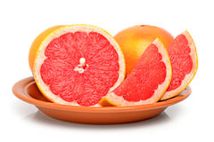 Grapefruits on a plate Stock Photos