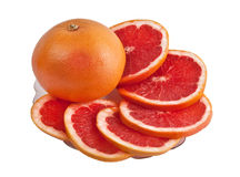 Grapefruits on the plate. Cut Grapefruits on the plate isolated on white background Stock Photo
