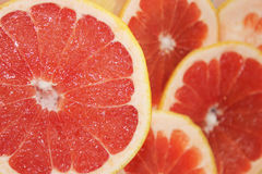 Grapefruits red cut by pieces Stock Image