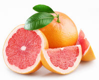 Grapefruits and segments with a leaves Royalty Free Stock Photography
