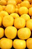 Grapefruits. A stack of yellow grapefruits Stock Photos