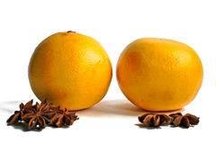 Grapefruits and Star Anise. Two grapefruits and star anise on a white background Royalty Free Stock Photos