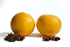 Grapefruits and Star Anise. Two yellow grapefruits and star anise on a white background Royalty Free Stock Image