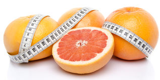 Grapefruits with a tape measure Stock Images