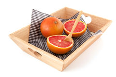 Grapefruits on tray Royalty Free Stock Image