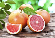 Grapefruits on a wooden table. Royalty Free Stock Image