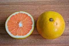 Grapefruits. On a wooden table Stock Images