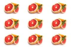 Grapefrukt med mintkaramellen på en vit bakgrund Arkivfoto