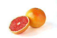 Grapefrukt med segment arkivbild