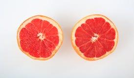 Grapefrukt på vit bakgrund arkivbild