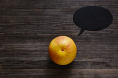 Grapefrukten med anförandebubblan har något att säga arkivbild