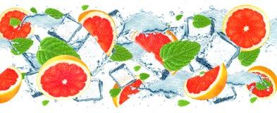 Grapefruktfärgstänkvatten Arkivfoto