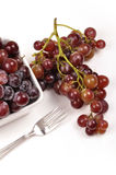 Grapes. Bunch of fresh grapes in bowl, one bunch out of them Stock Image
