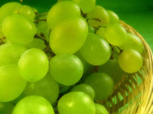 Grapes. Close up to a bunch of grapes with green background royalty free stock images