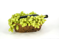Grapes. With a bottle of wine in a wicker basket Stock Photography